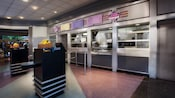 Condiment stands and service area of Auntie Gravity's Galactic Goodies in Tomorrowland