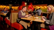 Smiling couples eating dinner in the booths at Jiko – The Cooking Place