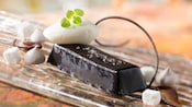 Chocolate pudding cake with meringue kisses and a sprig of mint