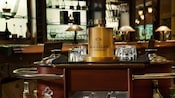 Dark wood and brass liquor cart with bottles on tumblers in the lounge section at Citricos