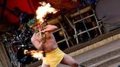Polynesian fire dancer in action