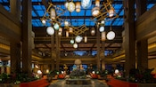 The spacious 3-story lobby at Disney's Polynesian Village Resort features a Tiki god as its centerpiece