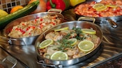 A stainless steel display featuring Friday Seafood Buffet offerings including salmon and shrimp