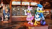 Daisy, Donald and displays of pins at Disney's Pin Traders at Downtown Disney Marketplace
