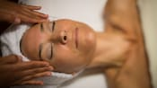 Close-up of a woman enjoying a facial massage at Senses – A Disney Spa at Disney's Saratoga Springs