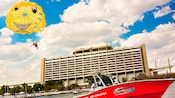 Motorboat pulling a couple tandem-parasailing in front of Disney's Contemporary Resort