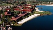 Bird's-eye view of a white sand beach in front of Disney's Polynesian Resort