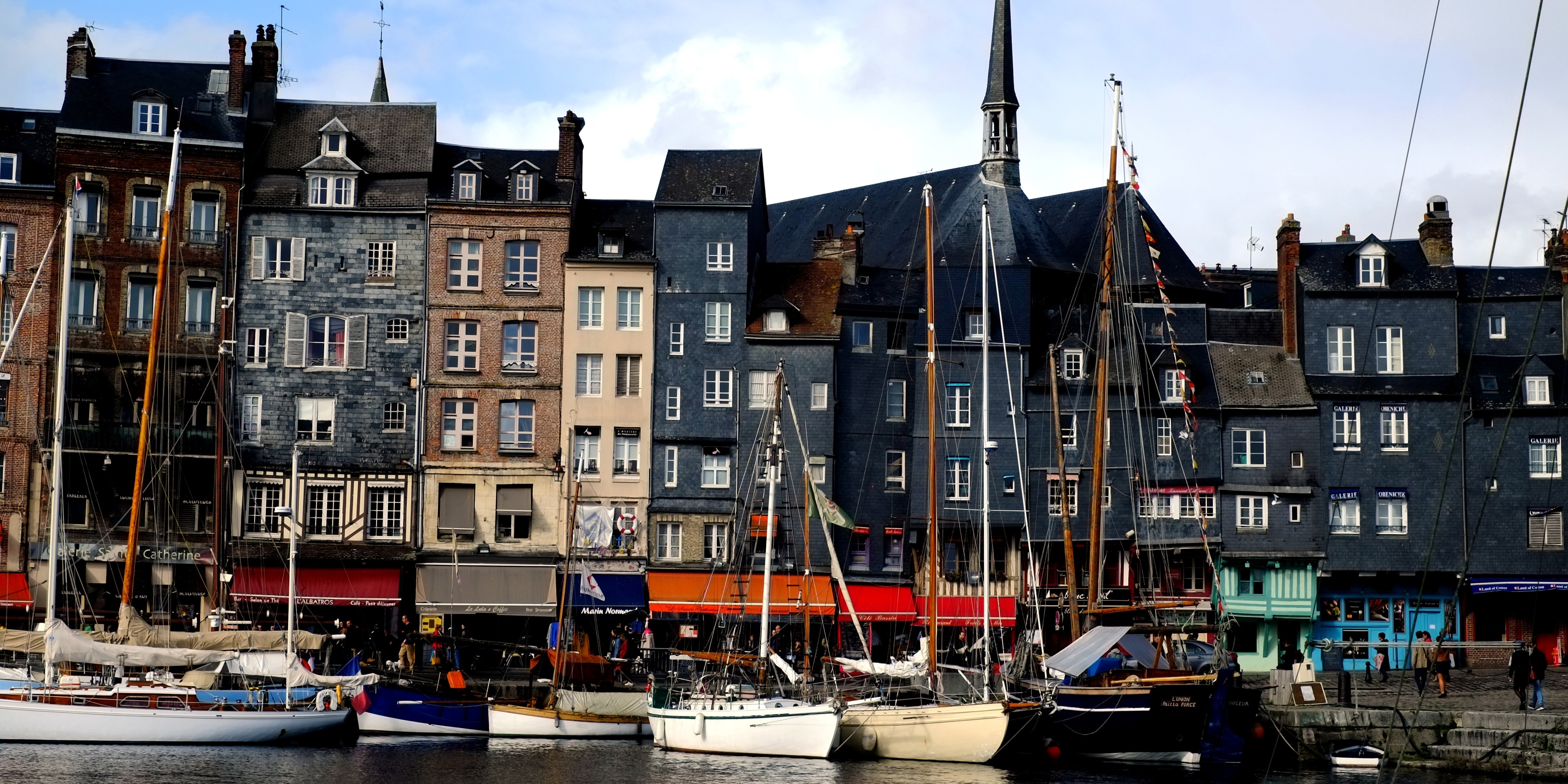 Boats anchored in the harbor of the coastal town of Honfleur