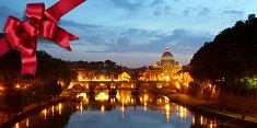 A nighttime view of St. Peter's Basilica in Vatican City from the Tiber River