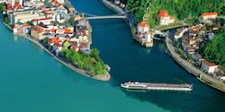 The AmaViola ship cruises down the Danube River near shores housing beautiful, quaint towns