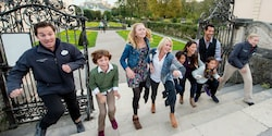 Guests and their Adventure Guides run up a set of stairs on a visit to a historic site