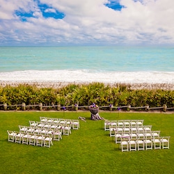 Chairs And Flowers Set Up On The Croquet Lawn Overlooking Ocean