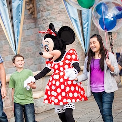 A family meets Minnie Mouse during a Magic Morning at Disneyland Park