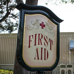 Sign for a First Aid location at the Disneyland Resort