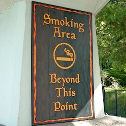 Disneyland Resort sign says, Smoking Area Beyond this Point