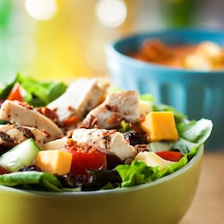 A healthy grilled chicken salad in a bowl
