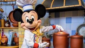 Chef Mickey lifts a canister handle inside his kitchen