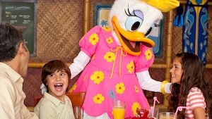 Daisy Duck chats with a girl and her brother while they're eating at one of the Resort restaurants