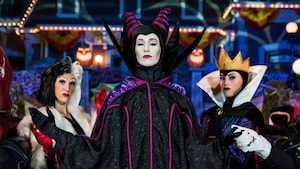 The Disney villainesses Cruella de Vil, Maleficent and the Evil Queen standing together at Mickey's Not So Scary Halloween Party