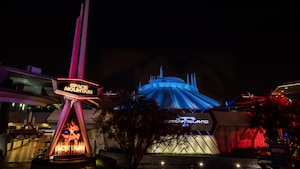 The exterior of Space Mountain at night