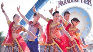 5 dancers in traditional Indian attire