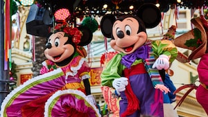 Minnie Mouse and Mickey Mouse dance on a stage