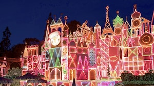 The illuminated holiday façade of the it's a small world attraction