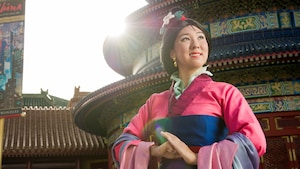 Mulan smiling while she awaits Guests during a Character Greeting experience at the China Pavilion