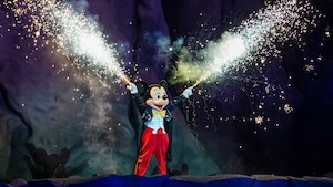 Sparks fly from Mickey's fingers during a performance of Fantasmic! at Disney's Hollywood Studios