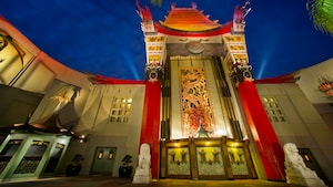 A reproduction of Grauman's Chinese Theatre rises into the evening sky at Disney's Hollywood Studios
