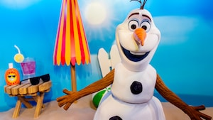 Olaf smiles while awaiting Guests at a Character Greeting experience at Disney's Hollywood Studios