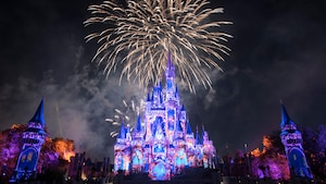 A fireworks and laser light show occurring above Cinderella Castle