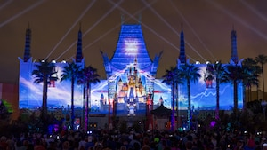 An image of Cinderella Castle projected onto the facade of Grauman's Chinese Theatre