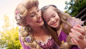 Rapunzel with her arms around a little girl