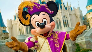 Mickey Mouse stands in front of Cinderella Castle dressed as a royal knight at the Mickey's Royal Friendship Faire