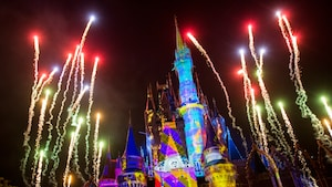 Fireworks and projections illuminate Cinderella Castle during Once Upon a Time at Magic Kingdom park