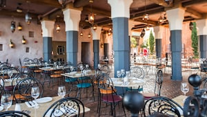 The dining patio at Spice Road Table with hanging lights and ceiling fans, in Epcot's Morocco Pavilion