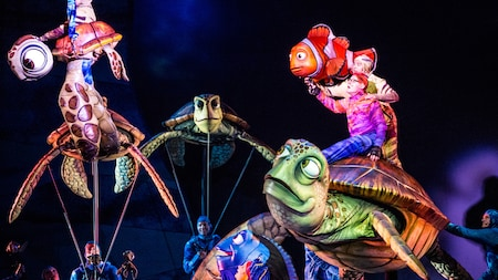 Performers hold puppets of characters from the Disney Pixar film Finding Nemo