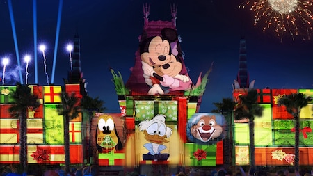 Images of Mickey Mouse, Minnie Mouse, Uncle Scrooge, Pluto and Dale are projected on a theater while a crowd watches
