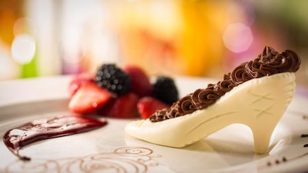 White chocolate shaped like Cinderella's glass slipper, topped with milk chocolate icing