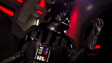 Darth Vader raises his fist menacingly during a 'Star Wars' experience at Disney's Hollywood Studios