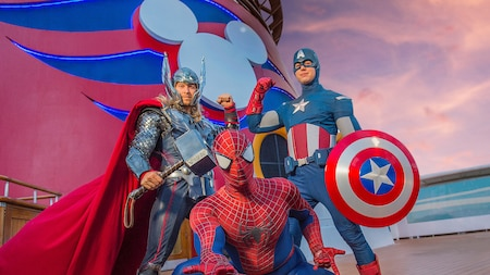Marvel superheroes Thor, Captain America and Spiderman pose together on the deck of a Disney Cruise Line ship