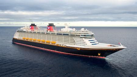 The Disney Fantasy ocean liner sailing the open seas