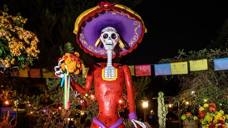 The figure of a female skeleton dressed in 19th century attire decorates a Spanish inspired plaza