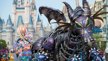 A steampunk style parade float of Maleficent in dragon form at Disney Festival of Fantasy Parade