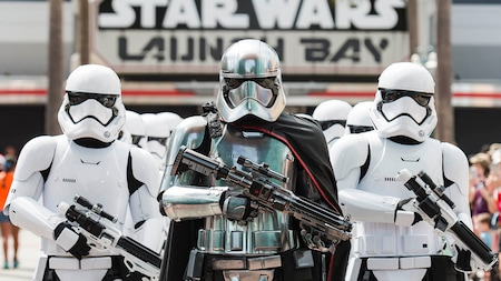 Looking armed and dangerous, Star Wars characters Captain Phasma and stormtroopers stand by Star Wars Launch Bay