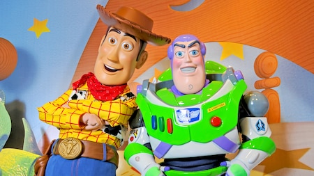 Woody and Buzz Lightyear await Guests of all ages during a Character Greeting experience at Pixar Place