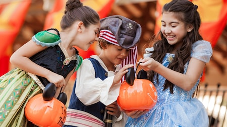 Children in costumes as Disney Princesses and pirates enjoying Mickey's Not-So-Scary Halloween Party