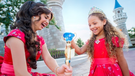 A young girl smiles while meeting Princess Elena of Avalor