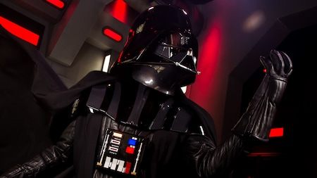 Darth Vader raises his fist menacingly during a 'Star Wars' experience at Disney's Hollywood Studios